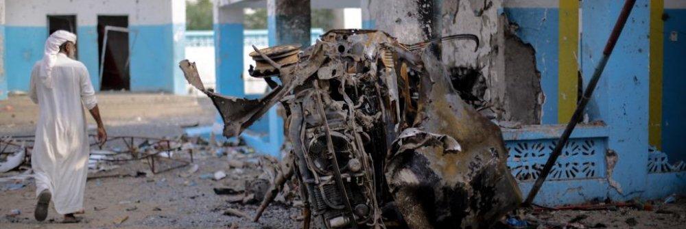 232559_photo_of_man_and_charred_car_msf_hospital_abs_yemen.jpg