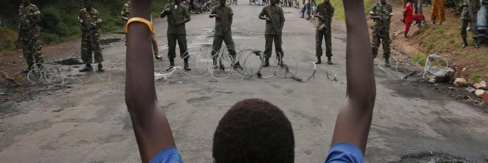 229341_protester_holds_his_hands_up_in_front_of_soldiers_during_a_protest_against_burundi_president_pierre_nkurunziza_and_his_bid_for_a_third_term_in_bujumbur.jpg