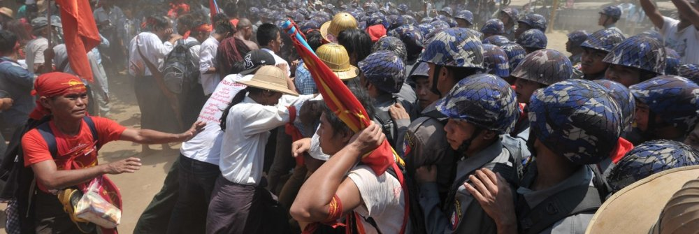 225563_myanmar_student_protesters_and_nationalists_clash_with_riot_police.jpg