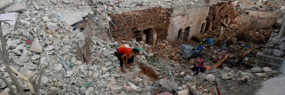 223529_civilians_inspect_a_site_hit_by_what_residents_said_were_airstrikes_carried_out_by_the_russian_air_force_in_the_town_of_darat_izza.jpg
