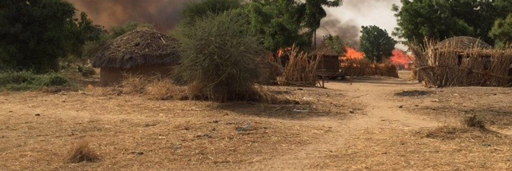 217841_houses_burning_following_an_attack_by_boko_haram_-_cameroon.jpg