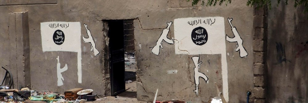 209149_a_wall_painted_by_boko_haram_is_pictured_in_damasak_01.jpg